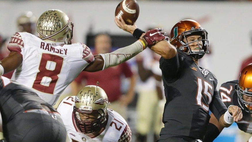 Florida State defensive back Jalen Ramsey (8) blocks a pass by Miami quarterback Brad Kaaya (15) during the second half of an NCAA College football game, Saturday, Nov. 15, 2014 in Miami Gardens, Fla. Florida State defeated Miami 30-26. (AP Photo/Wilfredo Lee)