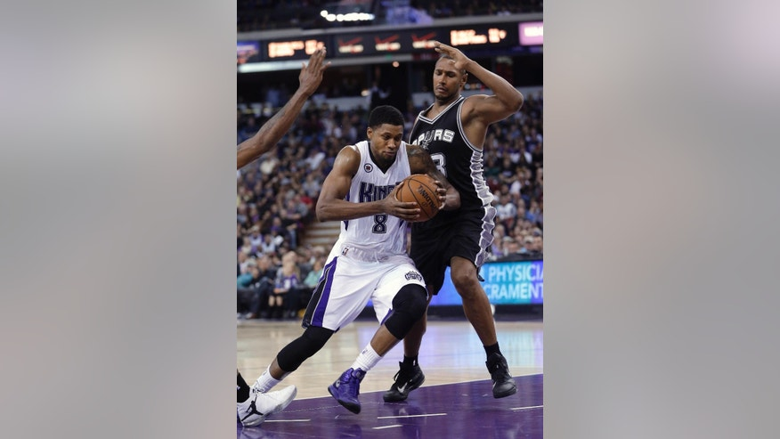 Sacramento Kings forward Rudy Gay, left, drives against San Antonio Spurs forward Boris Diaw, of France, during the second half of an NBA basketball game in Sacramento, Calif., Saturday, Nov. 15, 2014. The Kings 94-91. (AP Photo/Rich Pedroncelli)
