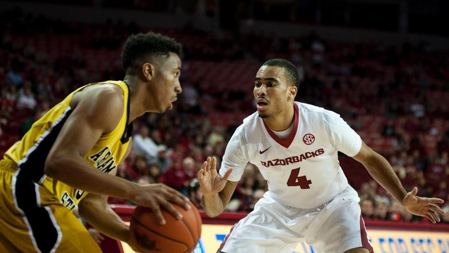 Arkansas' Jabril Durham (4) defends against Alabama State's DeMarcus Robinson, left, in the first half of an NCAA college basketball game in Fayetteville, Ark., Sunday, Nov. 16, 2014. (AP Photo/Sarah Bentham)