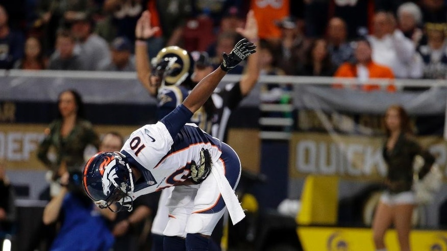 Denver Broncos wide receiver Emmanuel Sanders celebrates after catching a 42-yard pass for a touchdown during the second quarter of an NFL football game against the St. Louis Rams Sunday, Nov. 16, 2014, in St. Louis. (AP Photo/Charlie Riedel)