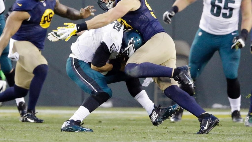 Green Bay Packers' Clay Matthews sacks Philadelphia Eagles quarterback Mark Sanchez during the first half of an NFL football game Sunday, Nov. 16, 2014, in Green Bay, Wis. (AP Photo/Tom Lynn)