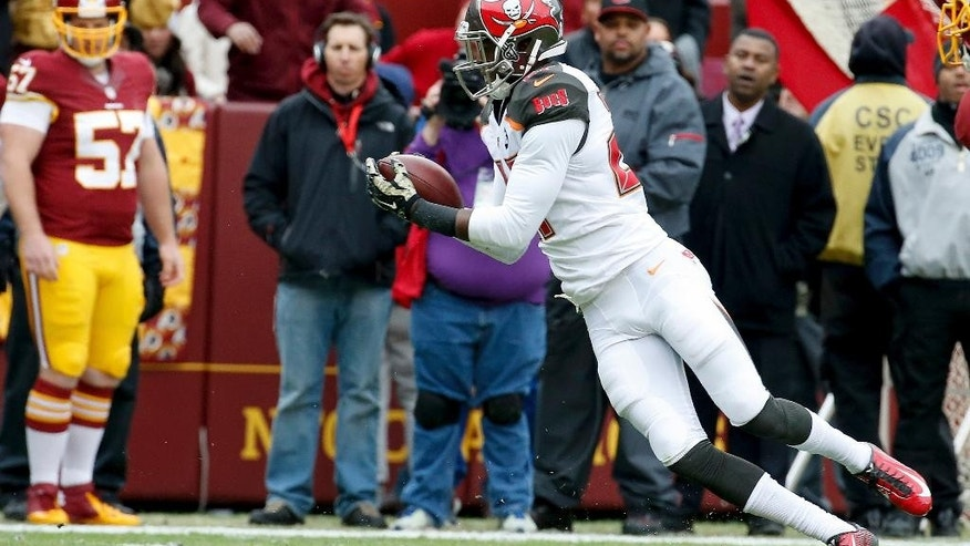 Tampa Bay Buccaneers cornerback Johnthan Banks (27) intercepts a Washington Redskins quarterback Robert Griffin III pass and heads for the end zone for a touchdown during the first half of an NFL football game in Landover, Md., Sunday, Nov. 16, 2014. (AP Photo/Alex Brandon)