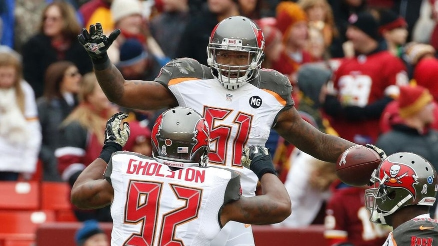 Tampa Bay Buccaneers outside linebacker Danny Lansanah (51) celebrates his interception of a Washington Redskins quarterback Robert Griffin III pass with teammate William Gholston (92) during the first half of an NFL football game in Landover, Md., Sunday, Nov. 16, 2014. (AP Photo/Alex Brandon)