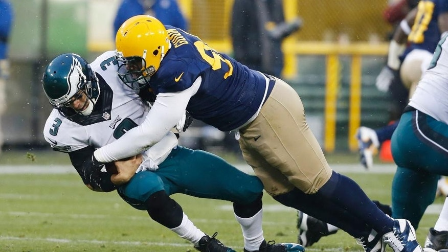 Green Bay Packers' Letroy Guion sacks Philadelphia Eagles' Mark Sanchez during the first half of an NFL football game Sunday, Nov. 16, 2014, in Green Bay, Wis. (AP Photo/Mike Roemer)