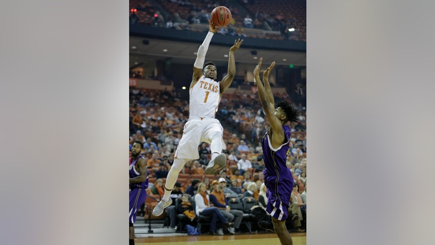 Texas' Isaiah Taylor (1) shoots over Alcorn State's Tyrel Hunt (0) during the first half of an NCAA college basketball game, Sunday, Nov. 16, 2014, in Austin, Texas. (AP Photo/Eric Gay)