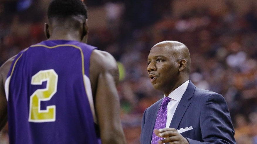 Alcorn State head coach Luther Riley, right, talks with Chris Miller (2) during the first half of an NCAA college basketball game against Texas, Sunday, Nov. 16, 2014, in Austin, Texas. (AP Photo/Eric Gay)