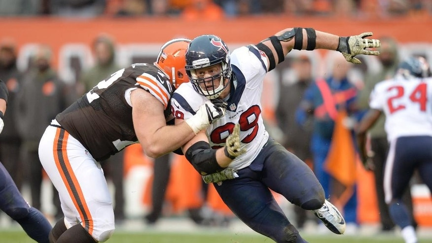 Houston Texans defensive end J.J. Watt (99) rushes against Cleveland Browns tackle Mitchell Schwartz in the third quarter of an NFL football game Sunday, Nov. 16, 2014, in Cleveland. (AP Photo/David Richard)