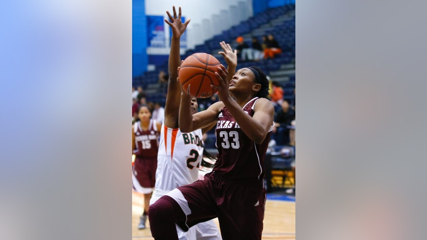 CORRECTS SPELLING OF BYLINE Texas A&M guard Courtney Walker, right, goes to the basket against UT Pan American guard Rickell Preston, left, during the first half of an NCAA women's college basketball game at McGrath-Phillips Arena in Chicago, on Sunday Nov. 16, 2014. (AP Photo/Kamil Krzaczynski)