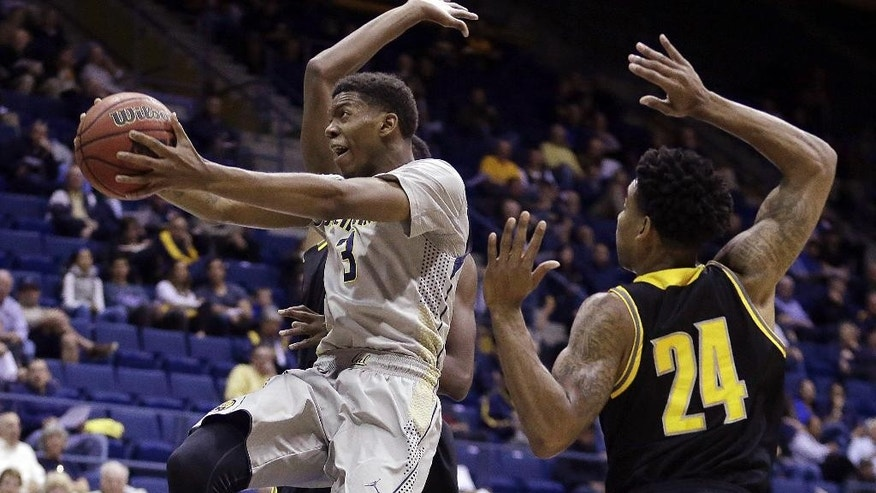 California's Tyrone Wallace, left, lays up a shot past Kennesaw State's Orlando Coleman in the first half of an NCAA college basketball game Sunday, Nov. 16, 2014, in Berkeley, Calif. (AP Photo/Ben Margot)