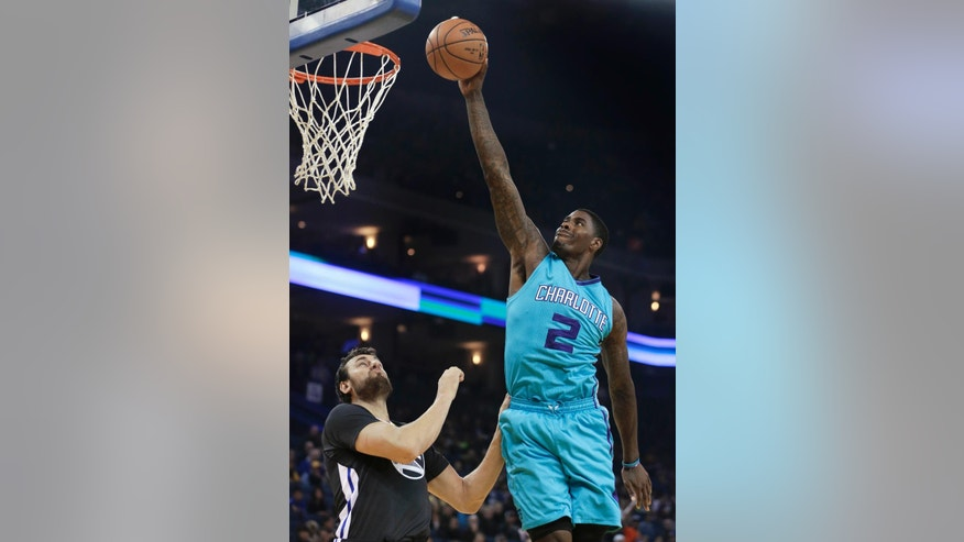2Charlotte Hornets' Marvin Williams (2) lays up a shot over Golden State Warriors' Andrew Bogut during the first half of an NBA basketball game Saturday, Nov. 15, 2014, in Oakland, Calif. (AP Photo/Ben Margot)