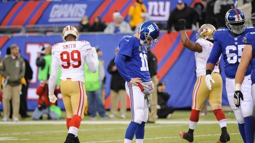 New York Giants quarterback Eli Manning (10) reacts after failing to score on fourth down during the second half of an NFL football game against the San Francisco 49ers, Sunday, Nov. 16, 2014, in East Rutherford, N.J.  (AP Photo/Bill Kostroun)