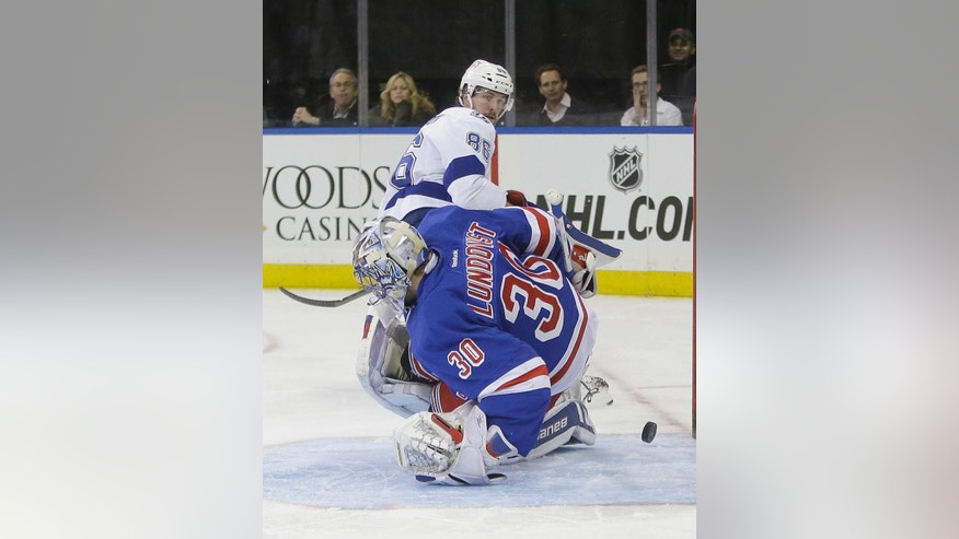 Tampa Bay Lightning's Nikita Kucherov (86), of Russia, scores on New York Rangers goalie Henrik Lundqvist (30), of Sweden, during the first period of an NHL hockey game Monday, Nov. 17, 2014, in New York. (AP Photo/Frank Franklin II)
