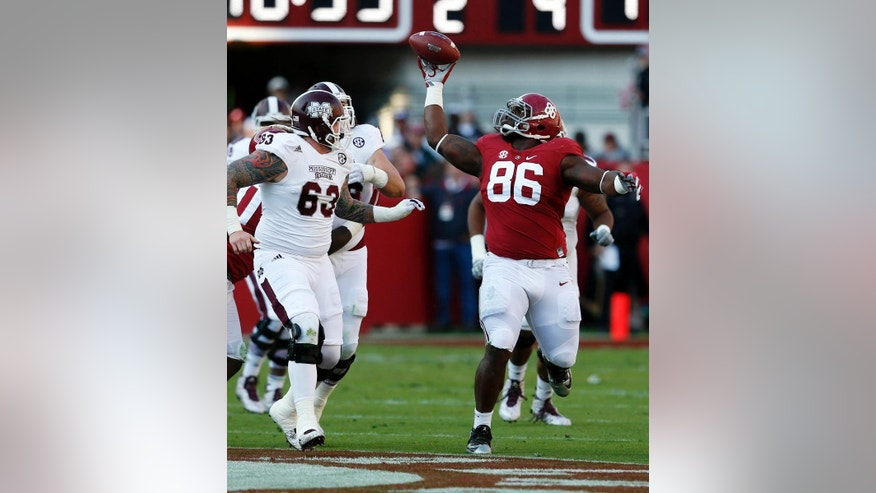 Alabama defensive lineman A'Shawn Robinson (86) tries to pull in an interception during the first half of an NCAA college football game against Mississippi State on Saturday, Nov. 15, 2014, in Tuscaloosa, Ala. (AP Photo/Butch Dill)
