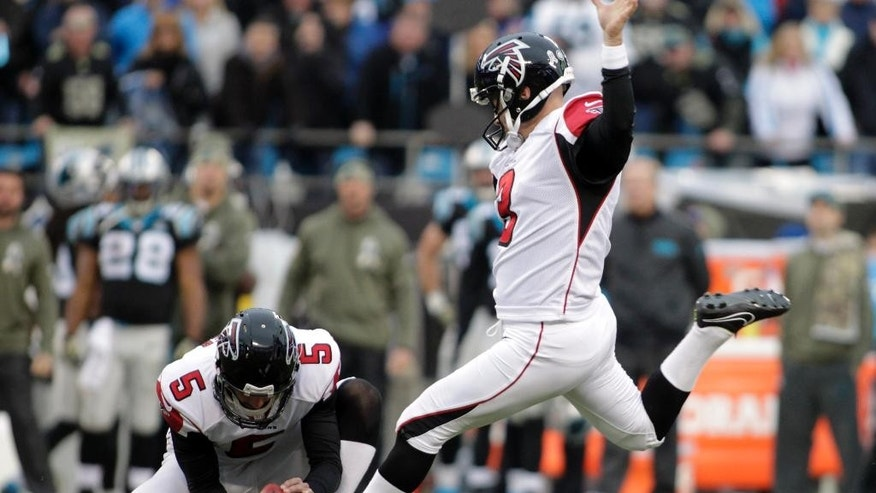 Atlanta Falcons' Matt Bryant (3) prepares to kick a field goal in the second half of an NFL football game against the Carolina Panthers in Charlotte, N.C., Sunday, Nov. 16, 2014. The Falcons won 19-17. (AP Photo/Bob Leverone)