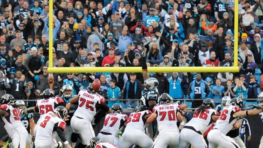 Atlanta Falcons' Matt Bryant (3) kicks a field goal in the second half of an NFL football game against the Carolina Panthers in Charlotte, N.C., Sunday, Nov. 16, 2014. The Falcons won 19-17.(AP Photo/Mike McCarn)