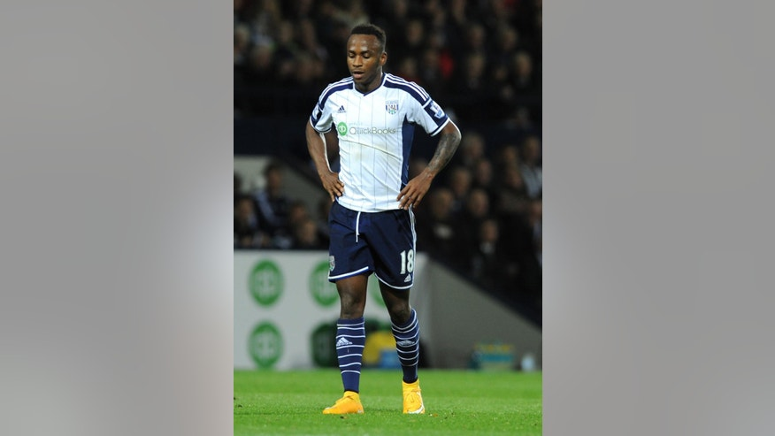 In this Monday, Oct. 20, 2014, file photo, West Brom's Saido Berahino during the English Premier League soccer match between West Bromwich Albion and Manchester United at the Hawthorns, Birmingham. Saido Berahino's path to becoming one of the new sensations of English football began with kickabouts on the streets of Burundi using a makeshift ball made from plastic bags or rolled-up socks. (AP Photo/Rui Vieira, File)