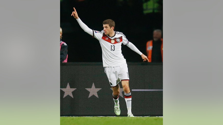 Germany's Thomas Mueller celebrates his side's second goal during a Group D Euro 2016 qualifying match between Germany and Gibraltar in Nuremberg, Germany, Friday, Nov. 14, 2014. (AP Photo/Michael Probst)