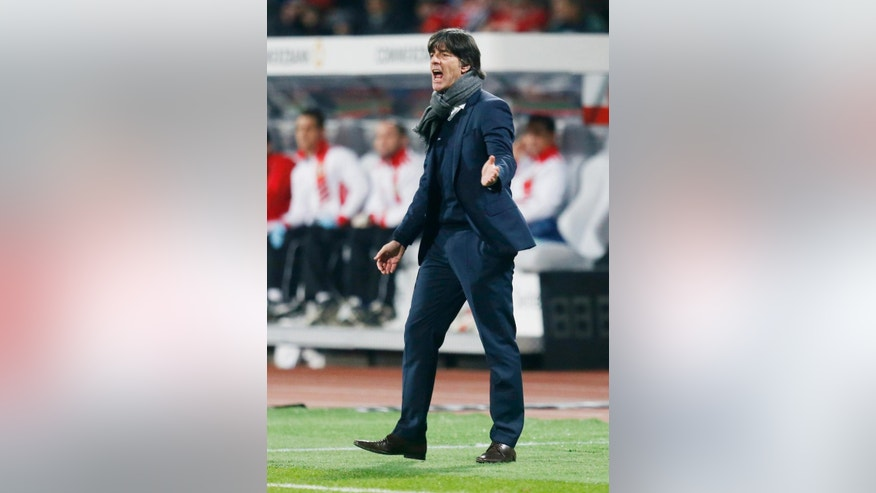 Germany's coach Joachim Loew reacts during a Group D Euro 2016 qualifying match between Germany and Gibraltar in Nuremberg, Germany, Friday, Nov.14, 2014. (AP Photo/Michael Probst)