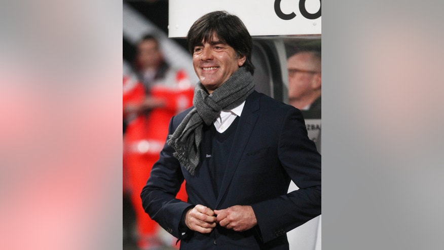 Germany's coach Joachim Loew smiles prior to a Group D Euro 2016 qualifying match between Germany and Gibraltar in Nuremberg, Germany, Friday, Nov. 14, 2014. (AP Photo/Michael Probst)