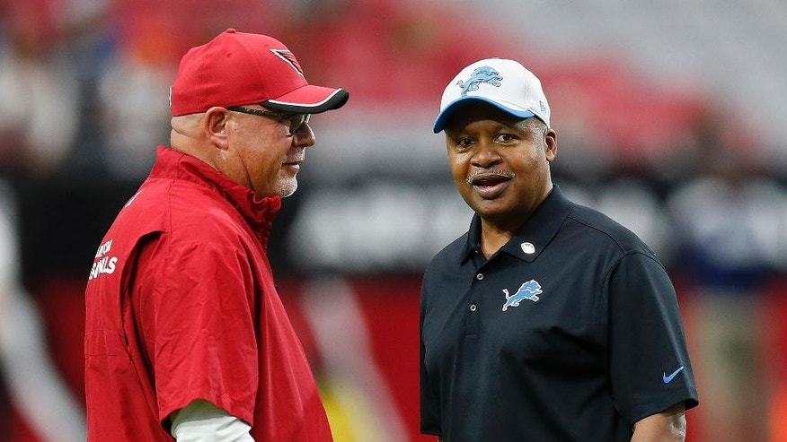 Detroit Lions head coach Jim Caldwell, right, chats with Arizona Cardinals head coach Bruce Arians, left, prior to an NFL football game, Sunday, Nov. 16, 2014, in Glendale, Ariz. (AP Photo/Ross D. Franklin)