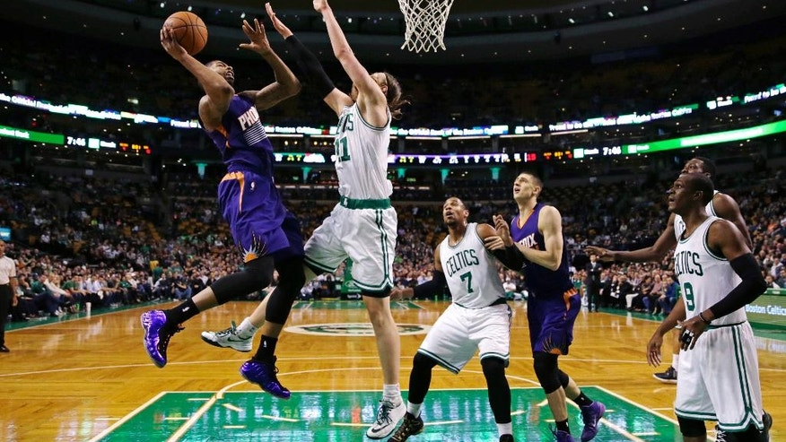 Phoenix Suns forward Markieff Morris, left, shoots over Boston Celtics center Kelly Olynyk during the first quarter of an NBA basketball game in Boston, Monday, Nov. 17, 2014. (AP Photo/Charles Krupa)