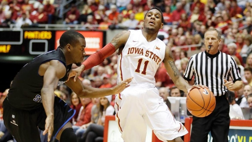 Iowa State guard Monte Morris, right, tries to drive past Georgia State guard Ryann Green during the first half of an NCAA college basketball game, Monday, Nov. 17, 2014, in Ames, Iowa. (AP Photo/Charlie Neibergall)
