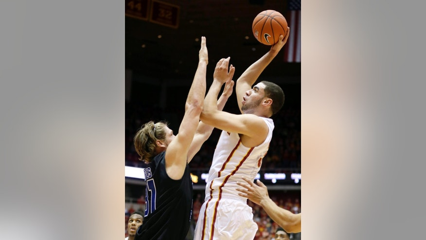 Iowa State forward Georges Niang, right, shoots over Georgia State forward T.J. Shipes during the first half of an NCAA college basketball game, Monday, Nov. 17, 2014, in Ames, Iowa. (AP Photo/Charlie Neibergall)