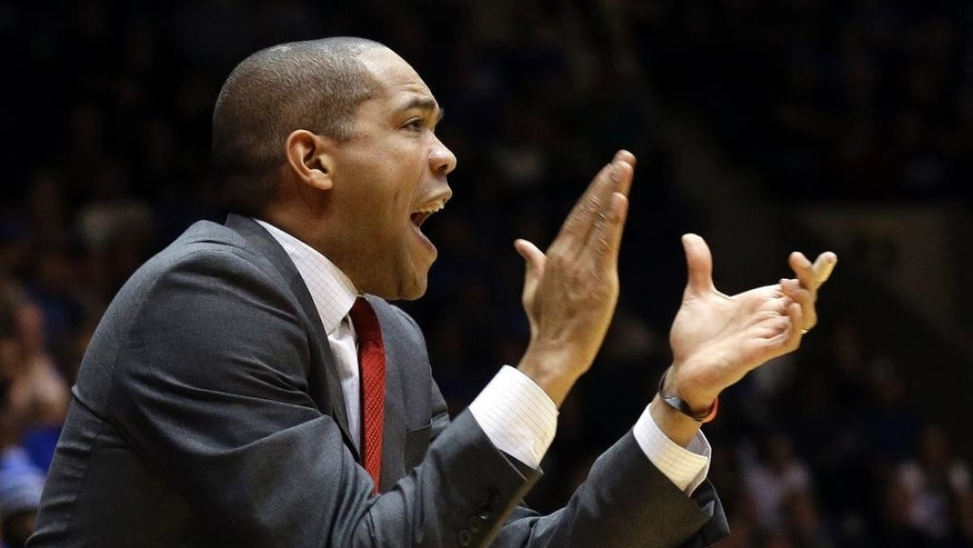 Fairfield coach Sydney Johnson applauds during the first half of an NCAA college basketball game against Duke in Durham, N.C., Saturday, Nov. 15, 2014. Duke won 109-59.(AP Photo/Gerry Broome)