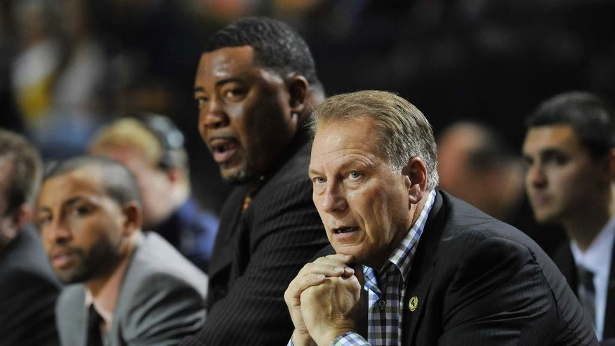 Michigan State head coach Tom Izzo watches his team against Navy during the second half of an NCAA college basketball game Friday, Nov. 14, 2014, in Annapolis, Md. Michigan State won 64-59. (AP Photo/Gail Burton)