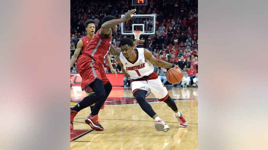 Louisville's Anton Gill, right, drives while Jacksonville State's D.J. Felder defends during the second half of an NCAA college basketball game Monday, Nov. 17, 2014, in Louisville, Ky. Louisville won 88-39. (AP Photo/Timothy D. Easley)