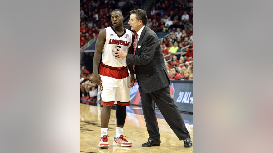 Louisville head coach Rick Pitino, right, talks with Chris Jones during the second half of an NCAA college basketball game against Jacksonville State, Monday, Nov. 17, 2014, in Louisville, Ky. Louisville won 88-39. (AP Photo/Timothy D. Easley)
