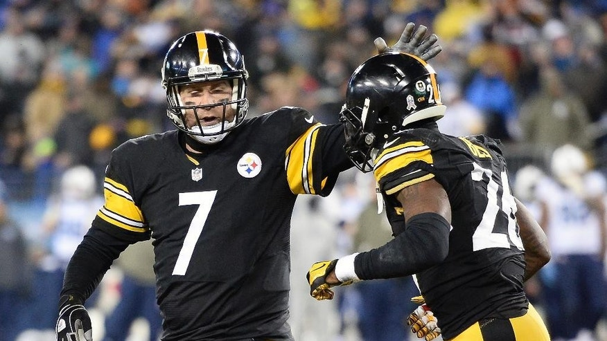 Pittsburgh Steelers quarterback Ben Roethlisberger (7) congratulates running back Le'Veon Bell (26) after Bell scored a touchdown on a 5-yard run against the Tennessee Titans in the second half of an NFL football game Monday, Nov. 17, 2014, in Nashville, Tenn. (AP Photo/Mark Zaleski)