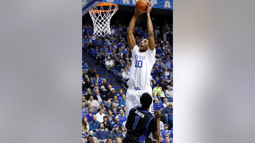 Kentucky's Marcus Lee, top, goes up for a dunk near Buffalo's Lamonte Bearden (1) during the first half of an NCAA college basketball game, Sunday, Nov. 16, 2014, in Lexington, Ky. (AP Photo/James Crisp)