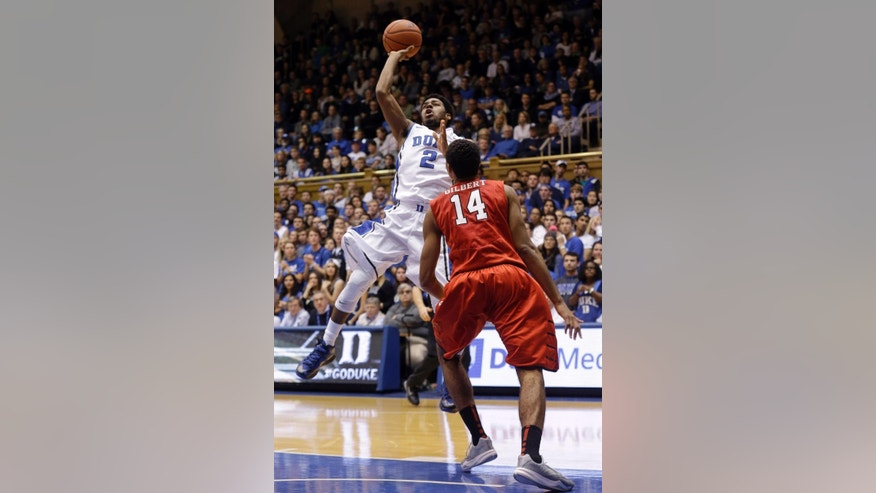 Duke's Quinn Cook (2) shoots over Fairfield's Marcus Gilbert (14) during the first half of an NCAA college basketball game in Durham, N.C., Saturday, Nov. 15, 2014. (AP Photo/Gerry Broome)