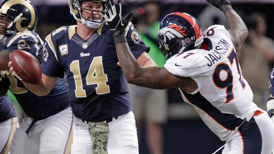 St. Louis Rams quarterback Shaun Hill, left, throws under pressure from Denver Broncos defensive end Malik Jackson during the third quarter of an NFL football game Sunday, Nov. 16, 2014, in St. Louis. (AP Photo/Tom Gannam)