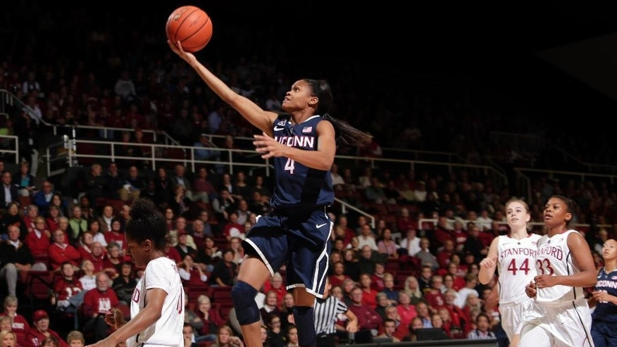 Connecticut guard Moriah Jefferson, center, goes up for a basket against Stanford during the first half of an NCAA college basketball game on Monday, Nov. 17, 2014, in Stanford, Calif. (AP Photo/Marcio Jose Sanchez)