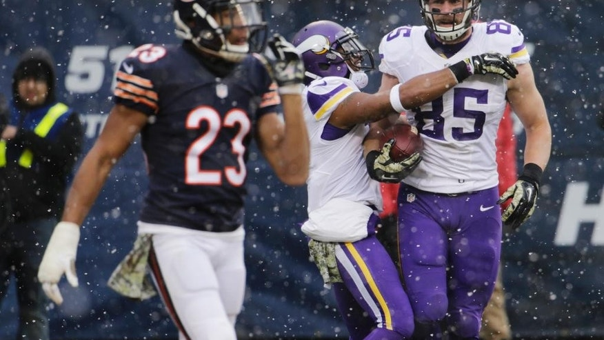 Minnesota Vikings quarterback Teddy Bridgewater (5) is sacked by Chicago Bears defensive end Jared Allen (69) during the first half of an NFL football game Sunday, Nov. 16, 2014 in Chicago. (AP Photo/Charles Rex Arbogast)