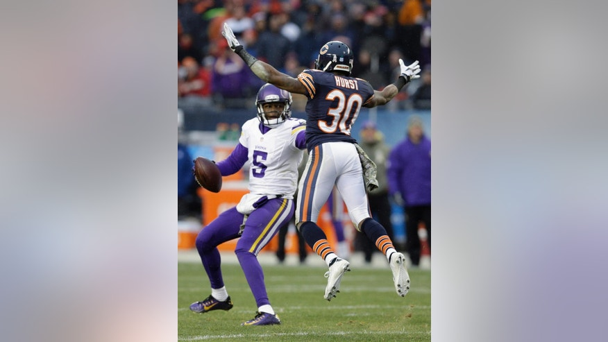 Chicago Bears cornerback Demontre Hurst (30) pressures Minnesota Vikings quarterback Teddy Bridgewater (5) during the second half of an NFL football game Sunday, Nov. 16, 2014 in Chicago. (AP Photo/Nam Y. Huh)