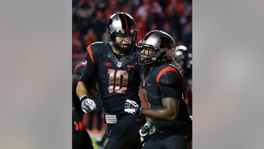 Rutgers quarterback Gary Nova (10) celebrates with running back Josh Hicks (8) after Hicks scored a touchdown during the second half of an NCAA college football game against Indiana, Saturday, Nov.15, 2014, in Piscataway, N.J. Rutgers won 45-23. (AP Photo/Mel Evans)