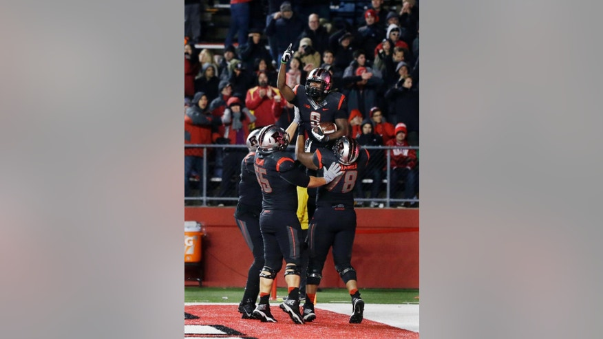 Rutgers running back Josh Hicks (8) celebrates with teammates after scoring a touchdown during the second half of an NCAA college football game against Indiana, Saturday, Nov.15, 2014, in Piscataway, N.J. Rutgers won 45-23. (AP Photo/Mel Evans)