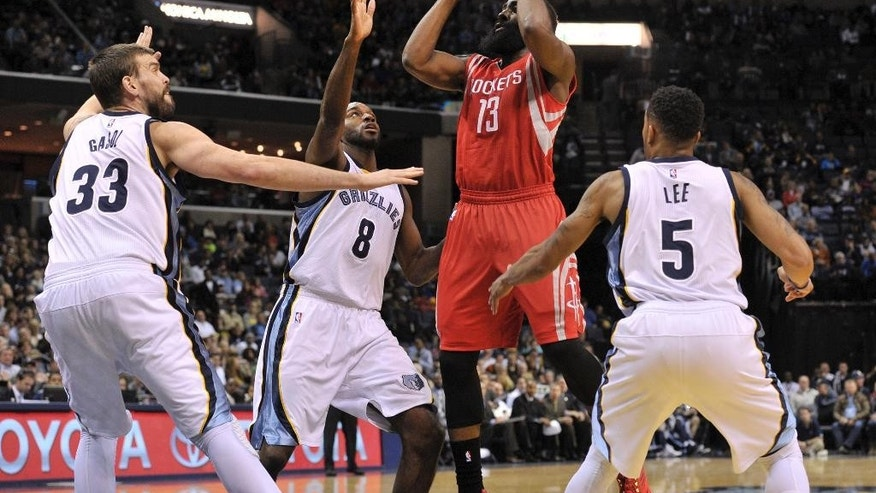 Houston Rockets guard James Harden (13) looks for a shot between Memphis Grizzlies center Marc Gasol (33), guard Quincy Pondexter (8) and guard Courtney Lee (5) in the first half of an NBA basketball game Monday, Nov. 17, 2014, in Memphis, Tenn. (AP Photo/Brandon Dill)