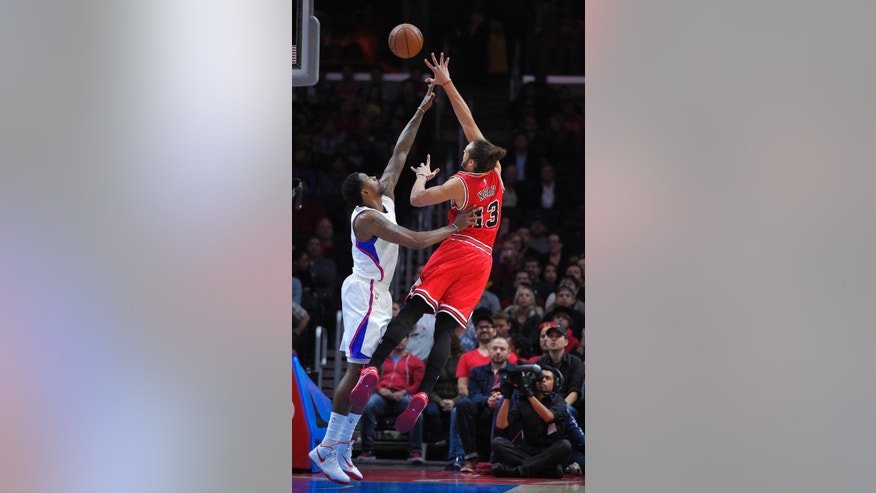 Chicago Bulls center Joakim Noah, right, puts up a shot as Los Angeles Clippers center DeAndre Jordan defends during the first half of an NBA basketball game, Monday, Nov. 17, 2014, in Los Angeles.  (AP Photo/Mark J. Terrill)