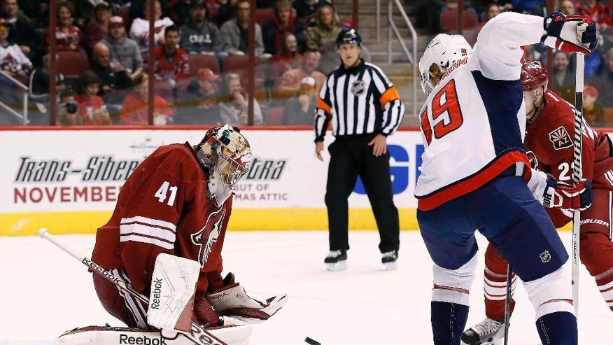 Arizona Coyotes' Mike Smith (41) makes a save on a shot by Washington Capitals' Nicklas Backstrom (19), of Sweden, during the first period of an NHL hockey game Tuesday, Nov. 18, 2014, in Glendale, Ariz. (AP Photo/Ross D. Franklin)