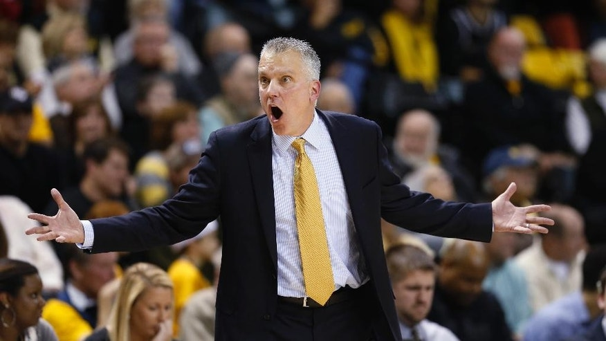 Toledo coach Tod Kowalczyk reacts to a call during the second half of his team's NCAA college basketball game against Virginia Commonwealth in Richmond, Va., Tuesday, Nov. 18, 2014. VCU won' 87-78. (AP Photo/Steve Helber)