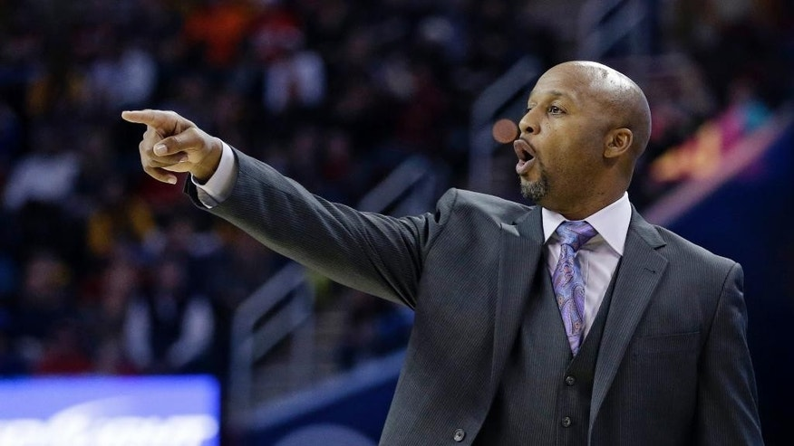 Denver Nuggets head coach Brian Shaw reacts during the second quarter of an NBA basketball game against the Cleveland Cavaliers, Monday, Nov. 17, 2014, in Cleveland. The Nuggets defeated the Cavaliers 106-97. (AP Photo/Tony Dejak)