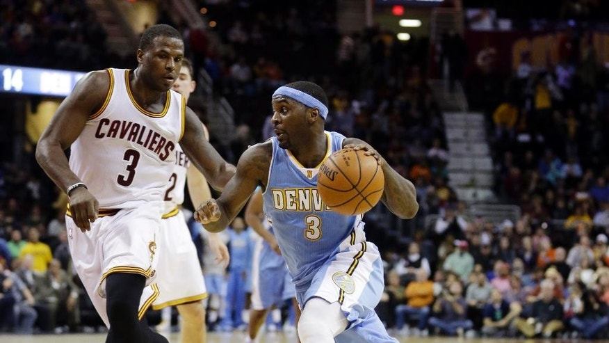 Denver Nuggets' Ty Lawson (3) drives past Cleveland Cavaliers' Dion Waiters (3) during the fourth quarter of an NBA basketball game Monday, Nov. 17, 2014, in Cleveland. The Nuggets defeated the Cavaliers 106-97. (AP Photo/Tony Dejak)