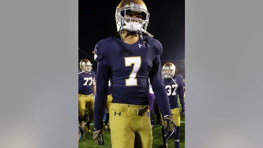 Notre Dame wide receiver Will Fuller (7) walks off the field after after Notre Dame's 43-40 loss to Northwestern in an NCAA college football game in South Bend, Ind., Saturday, Nov. 15, 2014. Northwestern won 43-40 in overtime. (AP Photo/Nam Y. Huh)