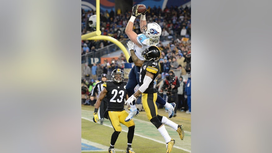 Tennessee Titans tight end Chase Coffman (86) catches a 4-yard touchdown pass as he is defended by Pittsburgh Steelers free safety Mike Mitchell (23) and Antwon Blake (41) in the second half of an NFL football game Monday, Nov. 17, 2014, in Nashville, Tenn. (AP Photo/Mark Zaleski)
