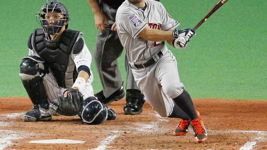 MLB All-Stars Jose Altuve hits a double in the sixth inning against Japan during Game-Five of their exhibition baseball series at Sapporo Dome in Sapporo, northern Japan, Tuesday, Nov. 18, 2014. (AP Photo/Kyodo News) JAPAN OUT, CREDIT MANDATORY