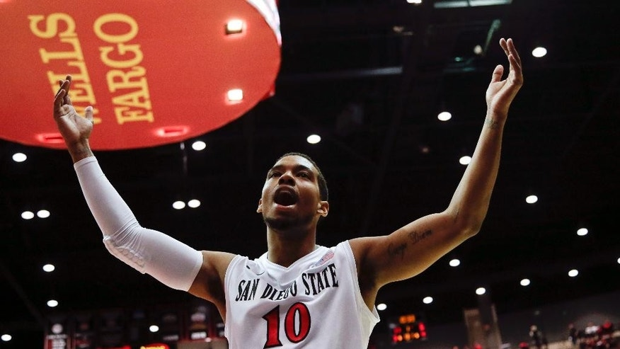 San Diego State guard Aqeel Quinn reacts to the crowd after a basket against Utah during the first half of an NCAA college basketball game Tuesday, Nov. 18, 2014, in San Diego. (AP Photo/Gregory Bull)